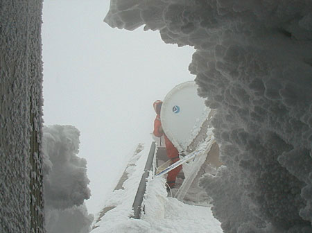 NOAA ETL scientist clearing ice from the PSR.